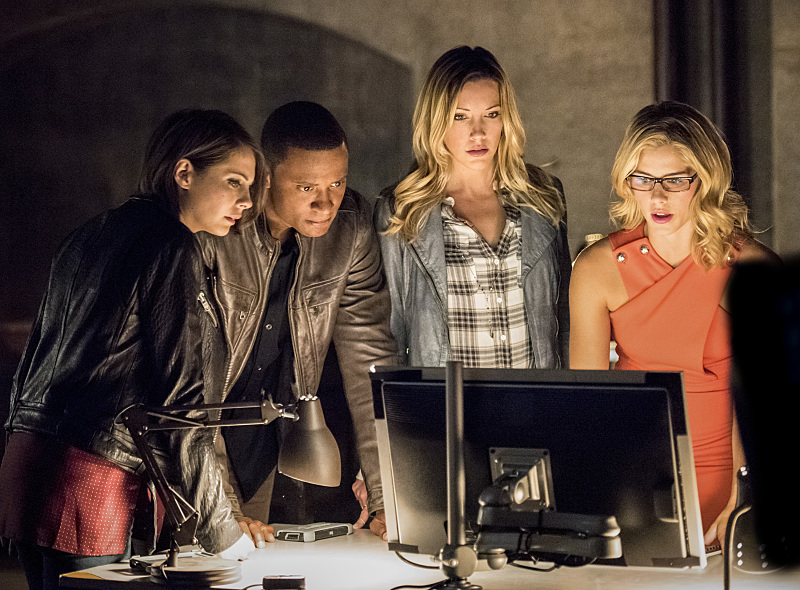 "Arrow -- ""Green Arrow"" -- Image AR401A_0192bc -- Pictured (L-R): Willa Holland as Thea Queen, David Ramsey as John Diggle, Katie Cassidy as Laurel Lance and Emily Bett Rickards as Felicity Smoak -- Photo: Dean Buscher /The CW -- �© 2015 The CW Network, LLC. All Rights Reserved."
